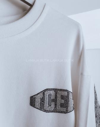 biała bluza ze skrzydłami lamaja butik 10