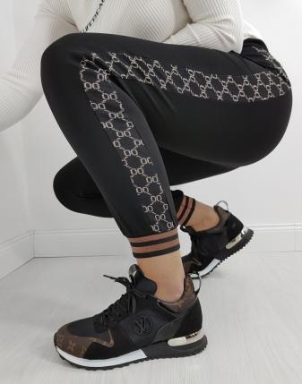 czarne spodnie z lampasem gucci